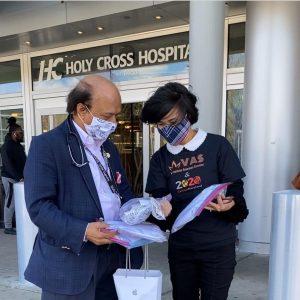 Executive Director Tho Tran meeting with Holy Cross Hospital representative.